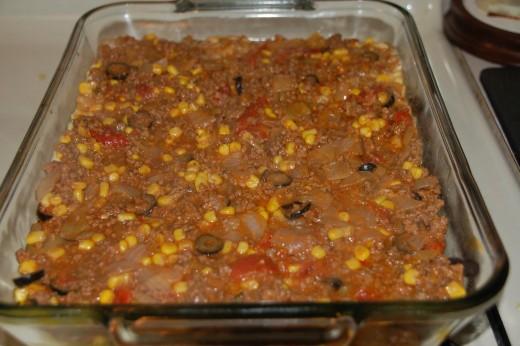 In the casserole dish ready for cornbread layer.