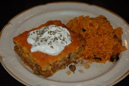 The Cornbread casserole topped with Greek yogurt and a little cilantro. It sides well with Spanish rice!