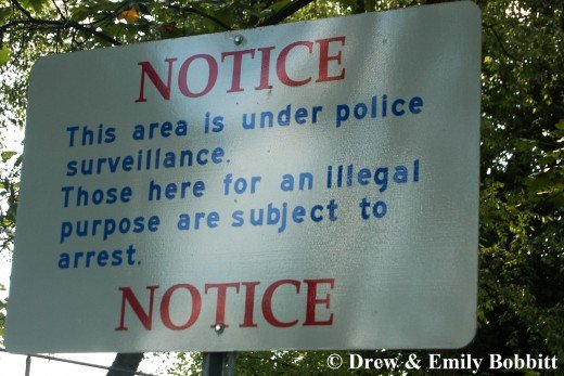 I found this sign to be quite ridiculous. Who would assume illegal activities would lead to an arrest?