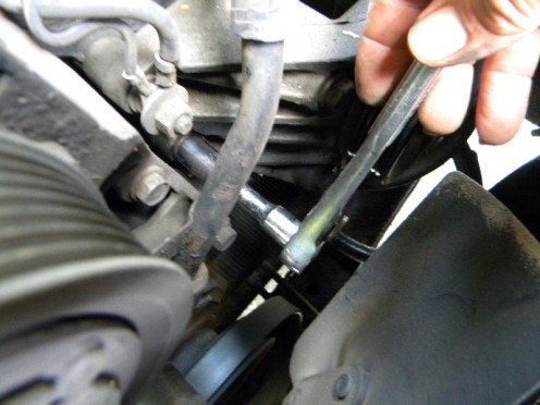 Remove the bolts from the pump bracket