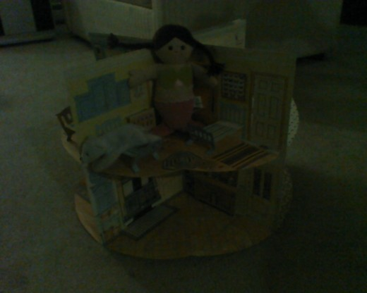 stuffed friends spending time in the paper pop-up dollhouse