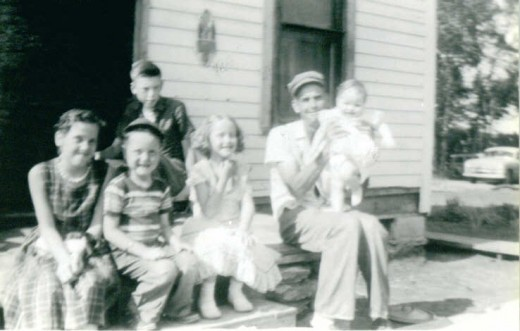 Home ownership can bring a family a sense of pride. This is a picture of my grandpa with my mom, aunts, and uncles.