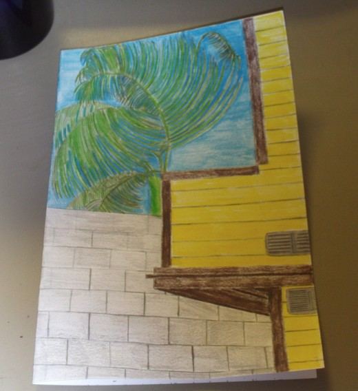 Here I conclude this colored pencil lesson by adding the finishing touch to the building, which I have decided to color in with a yellow hue.