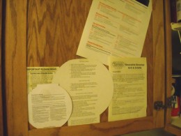 Those information papers, like small appliance directions and cookware care, won't get lost if you tape them to the inside of the cupboard door.