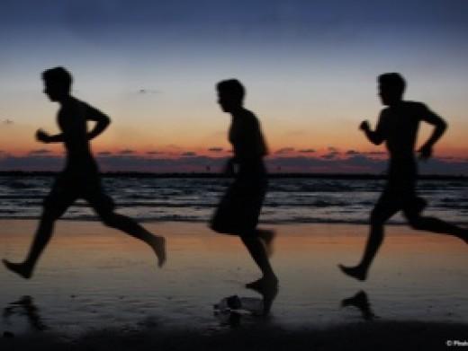 Boys running on the Beach      Courtesy of www.Photo8.com