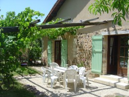 The gite has a southeast facing terrace for morning sun. It is shaded with grape vines.