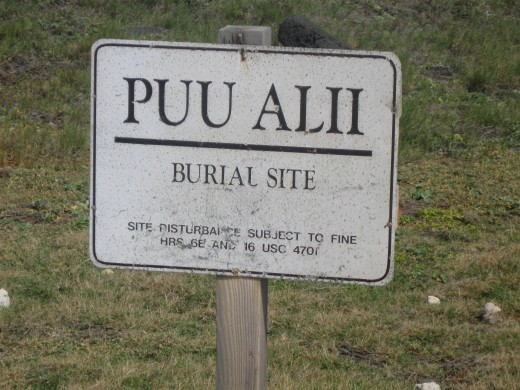 Sign informing passers by that this is a burial site.