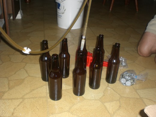 Siphoning the beer into the bottles.
