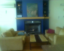 Lounge area with couches by a fp, a small section of our Great Room