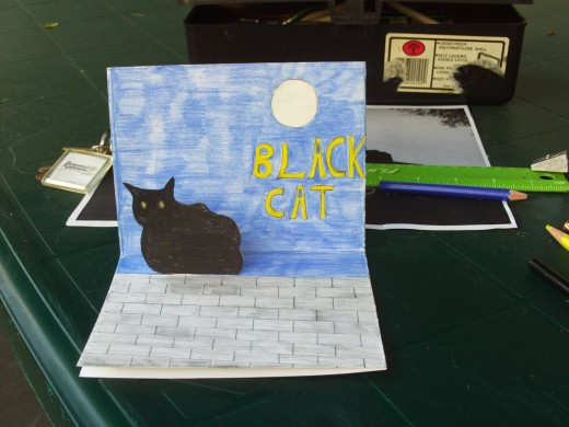 The card is complete now that the cat cut-out is glued on the pop-up card.