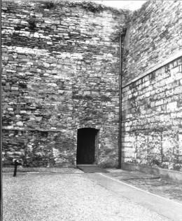 The cross marks the spot where thirteen of the men were shot in the Kilmainham Jail yard.