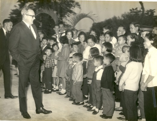 Governor Trench meeting staff and family members - Dad was the tallest man standing at the back, my brother, Man, was in the 1st roll wearing a checkered shirt.