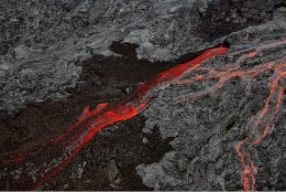 A'a lava flowing along with, Pahoehoe lava.