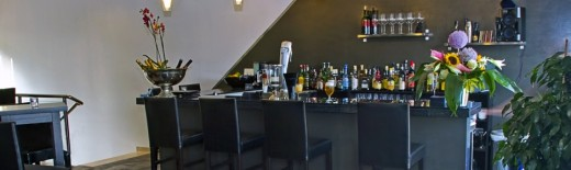 Enjoy a drink in comfortable and sophisticated surroundings while you browse the menu
