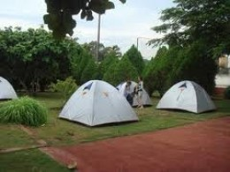 This is called Hostel Camping, tents provided