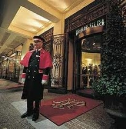 The doorman awaits to help you with your luggage at the Montreux Palace.