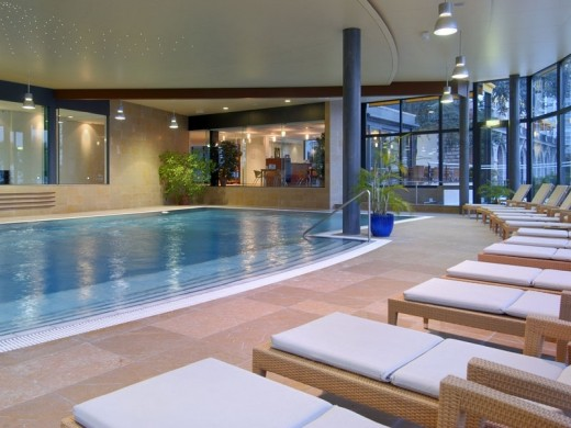 Relax by the pool while you enjoy your view of Lake Geneva.