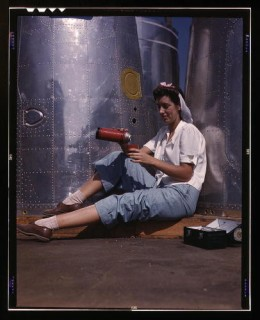 Title: Girl worker at lunch also absorbing California sunshine,  Douglas Aircraft Company, Long Beach, CA License Public Domain  Photographer The Library of Congress