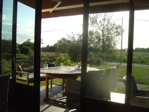 The glass front of the restaurant opens onto the terrace and Limousin countryside