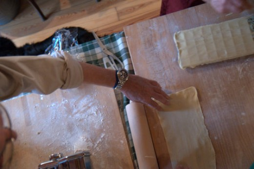 Cut the sheets of pasta two inches longer than the ravioli maker mold. When made with a pasta machine the sheets of dough are already of the right width.