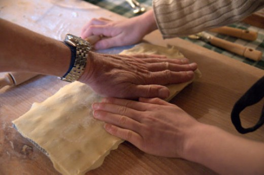 Lay a sheet of dough on top of the filling and press gently with the palms of your hands.