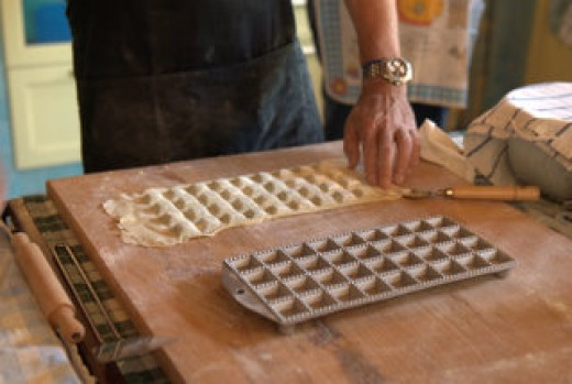Turn the mold upside down and get the uncut agnolotti out. If necessary gently tap the mold.