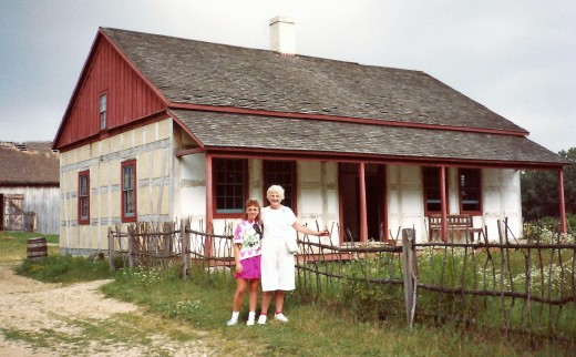 Photo of my aunt and niece next to one of the houses in Old   World Wisconsin