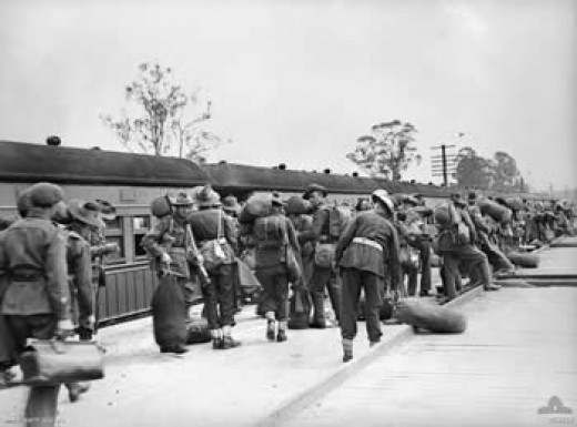 Australian troops alongside a troop train during World War Two