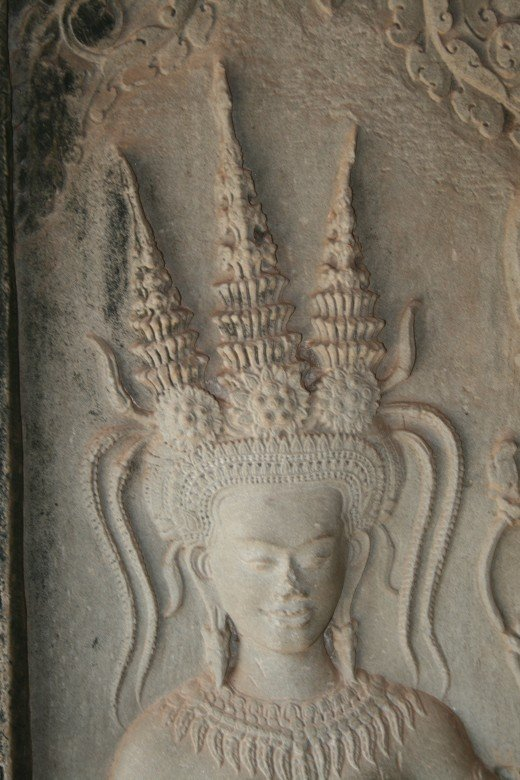 Apsara head showing intricate hair style