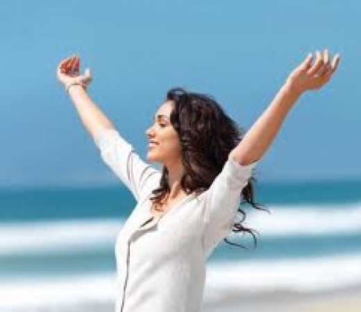 Look at how happy this woman is! (Maybe because she can afford beachfront property in California?) Somehow I don't think she's really that wildly excited about paying off her credit cards.