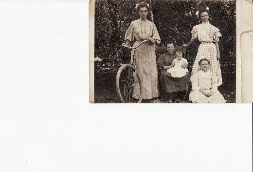 Georgetta and her sisters (Georgetta is on the far right in the cute gingham dress).