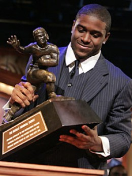 Bush in 2005, holding the soon to be stripped Heisman Trophy