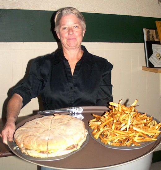 Speck's Owner Debbie Maichel with the 3-pound Speck Burger and homemade fries
