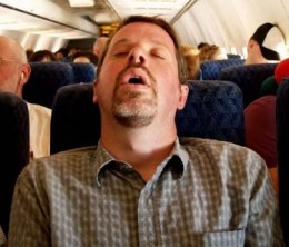 Trying to sleep on a plane without a neck pillow for travel. Not my idea of quality sleep!