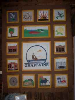Quilt in historical museum with images of Grapevine