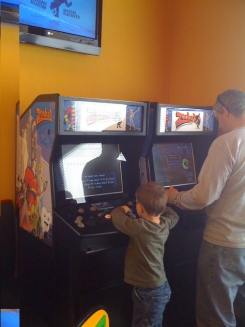 Children and parents enjoy video games while waiting for a dentist appointment at Zooka!