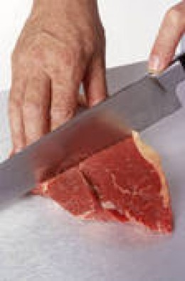 Cutting the steak in half (Wait until it is cooked)