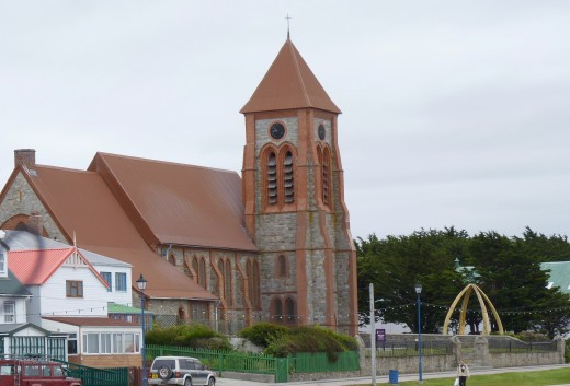 Christ Church Cathedral Anglican Church in downtown Stanley with its whalebone arch to the right.