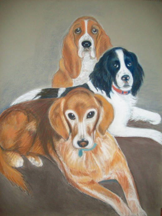 Here's a commissioned portrait I did a couple of summers back of a basset, springer, and golden retriever, in pastel.