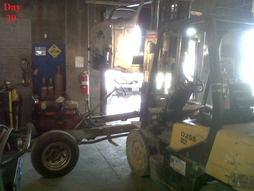 This pic is terrible, but it's a picture of my boss's 1946 Chevy pickup cab being lifted off the frame with the help of a forklift.