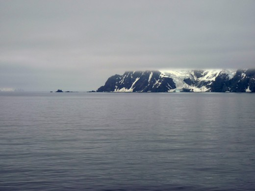 Elephant Island mountain top is hidden in the low cloud cover