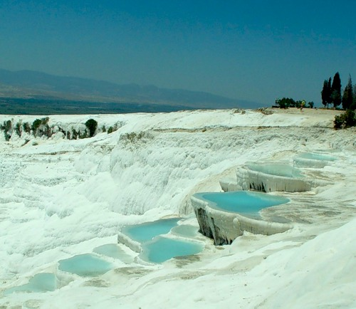 Pamukkale is one of the exclusive natural wonders of the world. These plateaus are formed by deposits of calcium carbonate formed deposits from the thermal springs over the millennia. These spas and mineral-rich springs are believed to be of great th