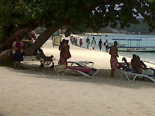 Sea, sand, sun, and shade.  Negril Beach, Jamaica.