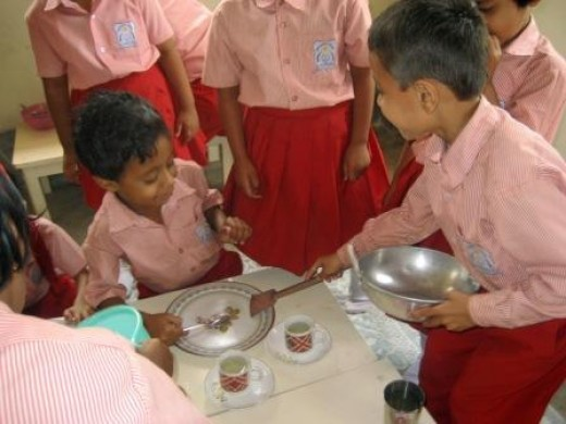 A group of kids playing in the kitchen. Image courtesy of Wikimedia.commons.org, from user Siamackz through a Creative Commons License.