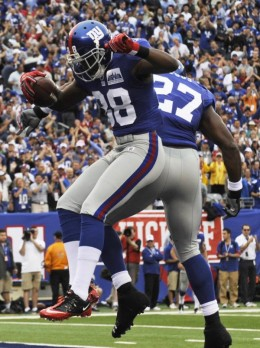 New York Giants wide receiver Hakeem Nicks (88) celebrates with Brandon Jacobs (27) after catching a touchdown pass during the first quarter of an NFL football game against the Carolina Panthers at New Meadowlands Stadium in East Rutherford, N.J., Su