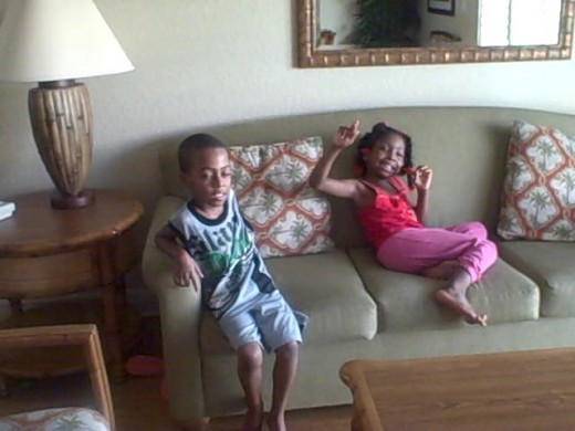 My son, and my six year old niece.  The children are watching a movie, and not making much of a mess.