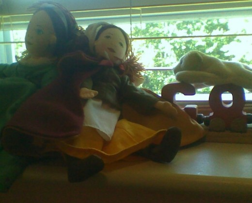 Windowsill with dolls and train