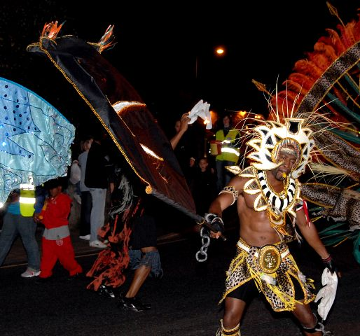 A Performer in the Torchlight parade.