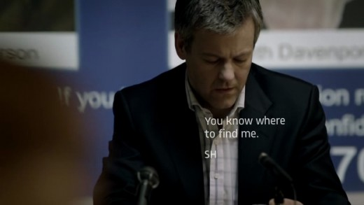 Lestrade (Graves) reads a text from Holmes.