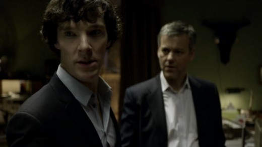 Sherlock Holmes (Benedict Cumberbatch) and Detective Inspector Lestrade (Rupert Graves) at 221B Baker Street.